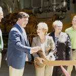 Congressman Todd Rokita and Secretary of State Connie Lawson share a chuckle as Secretary Lawson prepares to cut the ribbon.  IDEM Deputy Commissioner Bruce Palin, Danville Town Council President Marcia Lynch and Waste Management's Brad Eisenhart look on.